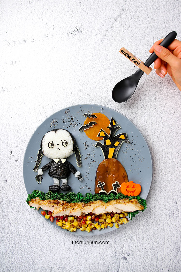 Monochromatic Wednesday Addams lunch with a colorful Maple Dijon Chicken salad! BforBunBun.com #bento #foodart