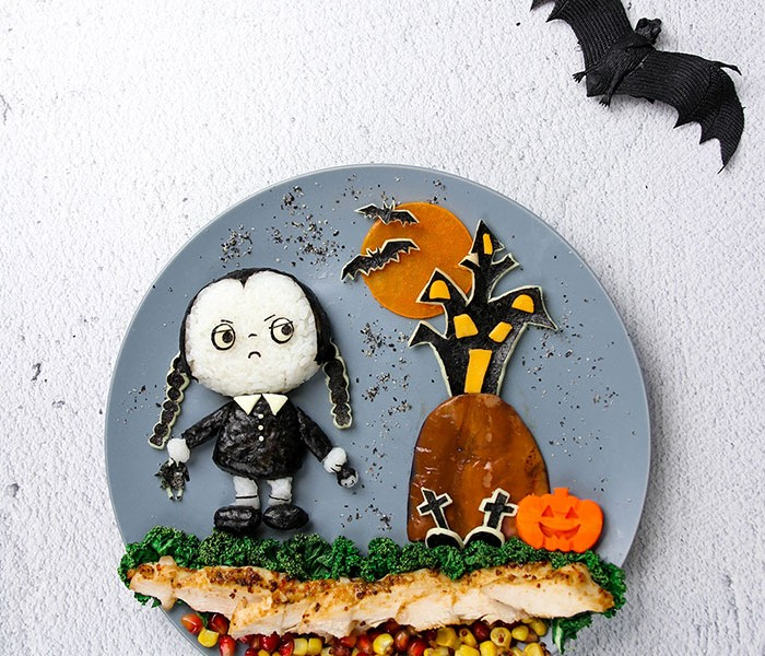 Put Wednesday Addams on a plate for a spooky and colorful lunch! Healthy Maple Dijon Chicken Salad recipe included! | BforBunBun.com #foodart #bento #halloween #lunchidea